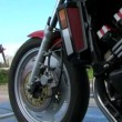 Motorcycle driving slowly down the road. Motorcycle on the road. — Stock Video