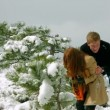 Stock Video: Mand womplaying snowballs in forest. Snowball fight. Slow motion.