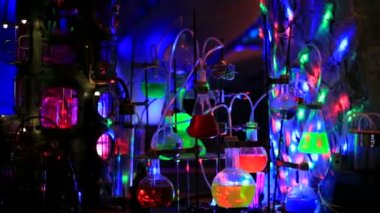 Chemical tubes and glasses on disco — Stock Video