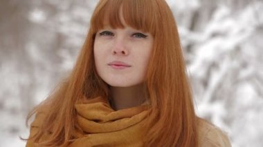 Happy and smiling winter girl outdoors in pinewood — Wideo stockowe