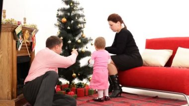 Family preparing to celebrate Christmas. — Stock Video