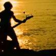Playing guitar on the beach at sunset. Playing guitar. — Stock Video