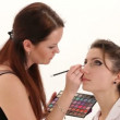 Make-up artist putting on make-up on model's eyes. Eye make-up. — Stock Video