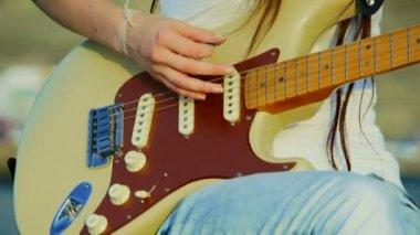 Girl playing guitar. Close-up. Playing guitar. — Stock Video