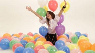Woman among colorful baloons. Among baloons. — Stock Video