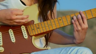 Young woman playing guitar. Close-up. Guitar chords. — Stock Video