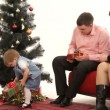 Child presenting gifts to her parents on New Year. Child on New Year. — Stock Video
