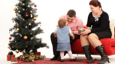 Family exchanging gifts on Christmas. Family gifts. — Stockvideo