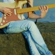 Young beautiful woman playing guitar outdoors. Playing guitar. — Stock Video #36012269