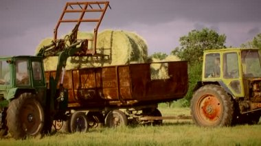 Tractor working in a field on a sunny day. Tractor in a field. — Vidéo