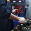 Stock Video: Mechanic repairing electrical starter. Repairing starter.