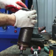 Stock Video: Mechanic working with electrical starter. Electrical starter.