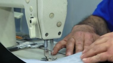 Machinist sewing lining of a car. Close-up. Sewing lining of a car. — Stock Video