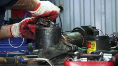 Repairing electrical starter. Maintenance. Close-up. — Stock Video