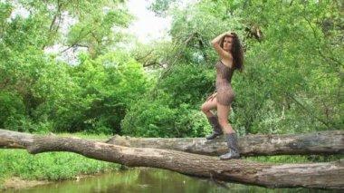 Woman on tree — Stock Video