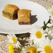 Two baklava with daisies — Stock Photo