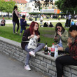 Young drinking and smoking in the park — Stock Photo