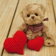 Teddy bear and two hearts — Stock Photo #33580435