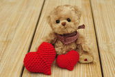 Teddy bear and two hearts — Stock Photo