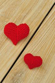 Two red hearts separated diagonally — Stock Photo