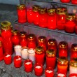 Grave candles on all saints day - Stock Photo