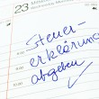 Entry in calendar: make tax return — Stock Photo #12574088