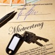 Stock Photo: Apartment keys and rental agreement