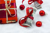 U.s. dollar bills with a bow as a gift of money — Stock Photo
