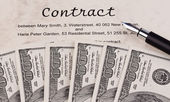 Dollar currency notes and english contract — Stock Photo