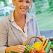 Woman at the fruit market with basket — Stock Photo #12582450