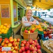 Woman at the fruit market with basket — Stock Photo