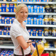 Woman shopping in the supermarket — Stock Photo