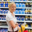 Woman shopping in the supermarket — Stock Photo #12582482