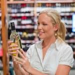 Woman in a supermarket wine shelf — Stock Photo #12582485