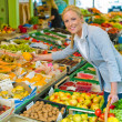 Woman at the fruit market with basket — Stock Photo #12582543