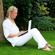 Stock Photo: Womwith laptop computer in garden