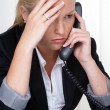 Frustrated womwith phone in office — Stock Photo #12582778