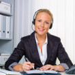 Friendly woman with headset in customer service — 图库照片