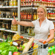 Woman shopping in the supermarket — Stock Photo #12582861