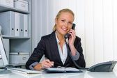 Woman with phone in office — Stock Photo