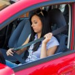 Woman with safety belt in a car — Stock Photo