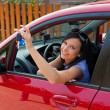 Woman with new car and car keys — Stock Photo #12823278