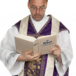 Catholic priest with bible in church — Stock Photo #12824113