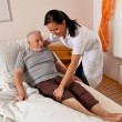 Nurse in elderly care for the elderly in nursing homes — Stock Photo #12824121