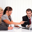 Stock Photo: Successful team at meeting in office