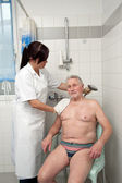 Senior is bathed by nurses — Stock Photo