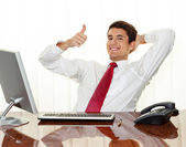 Successful manager sitting at desk — Stock Photo