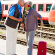 Stock Photo: Mature aged couple at the train station