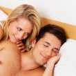 Couple has fun in bed. laughter, joy and eroticism — Stock Photo