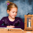 Child with book and lantern in advent — Stockfoto